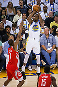 Golden State Warriors forward Kevin Durant (35) shoots a jumper against the Houston Rockets at Oracle Arena in Oakland, Calif., on October 17, 2017. (Stan Olszewski/Special to S.F. Examiner)