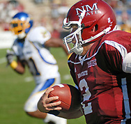 Robin Zielinski/Sun-News<br /> New Mexico State University Quarterback Matt Christian runs the ball for a 28 yards touchdown run with 7:47 left in the second quarter to give the aggies a 14-3 lead.  The Aggies went on to win the game against San Jose State with a nail biting ending and a score of 29-27.