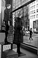 Mannequins serenely keeping watch over Fifth Avenue in midtown Manhattan.