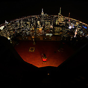 A panoramic fisheye view of Manhattan, New York, at night time from the Top of the Rock, the observatory deck at Rockefeller Center showing the Empire State Building, Manhattan, New York, USA.  Photo Tim Clayton
