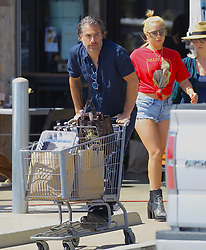 Lady Gaga and boyfriend Christian Carino are seen shopping for Fourth of July groceries at Vintage Grocers in Malibu. Lady Gaga wore a red Notorious BIG t-shirt with denim Daisy Dukes Shorts and black studded boots. 02 Jul 2017 Pictured: Lady Gaga. Photo credit: ROMA / MEGA TheMegaAgency.com +1 888 505 6342
