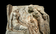 """Close up of a Roman Sebasteion relief  sculpture of Io and Argos Aphrodisias Museum, Aphrodisias, Turkey.   Against a black background.<br /> <br /> A powerful hero is folding a sword gazing closely at a half naked and dishevelled young heroine who sits on a chest like stool. Between, on a pillar base stood a small, separately added statue of a goddess ( now missing). The scene follows a scheme used in the relief panels """"Io guarded by Argos"""". Io was one of Zeus's lovers, and Argos was a watchful giant sent to guard her by Hera, Zeus's wife. .<br /> <br /> If you prefer to buy from our ALAMY STOCK LIBRARY page at https://www.alamy.com/portfolio/paul-williams-funkystock/greco-roman-sculptures.html . Type -    Aphrodisias     - into LOWER SEARCH WITHIN GALLERY box - Refine search by adding a subject, place, background colour, museum etc.<br /> <br /> Visit our ROMAN WORLD PHOTO COLLECTIONS for more photos to download or buy as wall art prints https://funkystock.photoshelter.com/gallery-collection/The-Romans-Art-Artefacts-Antiquities-Historic-Sites-Pictures-Images/C0000r2uLJJo9_s0"""