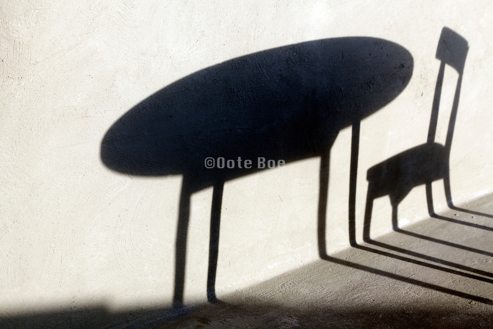 shadow of a round table with one chair