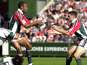 Leicester, 13th September 2003, Zurich Premiership Rugby,  Welford Road, <br /> [Mandatory Credit; Peter Spurrier/Intersport Images]<br /> Zurich Premiership Rugby - Leicester Tigers v London Irish.<br /> Leon Lloyd [tackled by Naka Drotske,  scull cap, and Keiron Dawson] passes the ball  to John Holtby