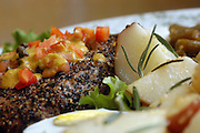Leander's On Oak: Tuna Nicoise - Grilled pepper-encrusted tuna steak served with roasted red potatoes, green beans, bolied eggs and a tomato and wasabi lime viniagrette.