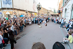 stock photo of a street proformer in russia in mid air