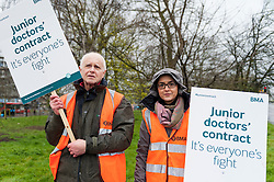 © Licensed to London News Pictures. 06/04/2016. London, UK.  Junior doctors stand at their picket line outside Northwick Park Hospital in Harrow, north west London.  This is the fourth junior doctors strike against contract changes to pay and conditions. Photo credit : Stephen Chung/LNP