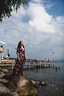 Zurich, Switzerland - August 18, 2018: Marta, from Spain, stands on the shore of Lake Zurich.