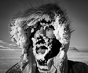 Skier Colin Monteath with frosted face after skiing across Svalbard, Norwegian Arctic