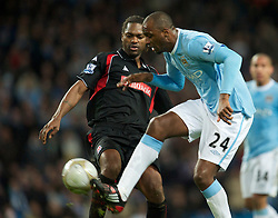 MANCHESTER, ENGLAND - Sunday, February 13, 2010: Manchester City's Patrick Vieira and Stoke City's Salif Diao during the FA Cup 5th Round match at the City of Manchester Stadium. (Photo by David Rawcliffe/Propaganda)  MANCHESTER, ENGLAND - Sunday, February 13, 2010: Manchester City xxxx and Stoke City's xxxx during the FA Cup 5th Round match at the City of Manchester Stadium. (Photo by David Rawcliffe/Propaganda)