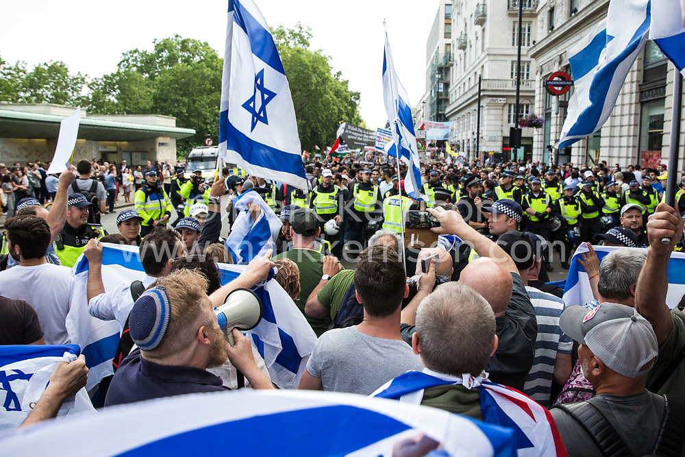 London, UK. 10th June, 2018. Pro-Israel activists holding Israeli flags protest in front of the pro-Palestinian Al Quds Day march through central London organised by the Islamic Human Rights Commission. An international event, it began in Iran in 1979. Quds is the Arabic name for Jerusalem.
