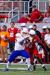 NORMAL, IL - September 07: Kevin Brown swoops in on Landon Hurst during a college football game between the ISU (Illinois State University) Redbirds and the Morehead State Eagles on September 07 2019 at Hancock Stadium in Normal, IL. (Photo by Alan Look)