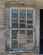 Window and reflection in old wooden house in Grafton, Utah ghost town.  Location of bicycle scene from movie Butch Cassidy and the Sundance Kid