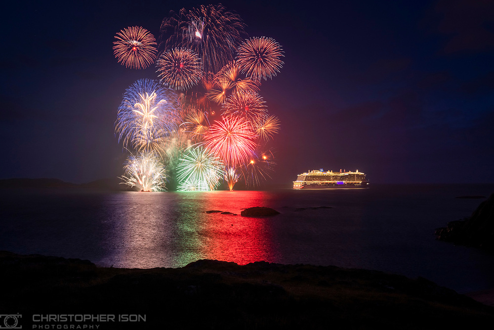 """Immediate release: Monday August 9, 2021 - Editorial free to use image.<br /> <br /> Fireworks celebrate maiden voyage of P&O Cruises Iona to namesake island<br /> <br /> Britain's largest and most environmentally-friendly cruise ship, P&O Cruises Iona, has embarked on its maiden voyage visiting its Scottish namesake island with a fireworks display as the highlight of celebrations.<br /> <br /> P&O Cruises President Paul Ludlow said: <br /> <br /> """"Iona's maiden voyage is the start of a new era in travel as Britain's most environmentally-friendly cruise ship, the first in the country powered by liquefied natural gas, sets sail.<br /> <br /> """"For this special maiden voyage we wanted to bring guests to the island of Iona which has influenced many aspects of the ship – the sense of space in the SkyDome through to our gin still named """"Columba"""", the heather in our Marabelle gin distilled on board and, of course, the name of the ship.""""<br /> <br /> Iona's first-ever cruise is currently sailing around the UK coast, for seven nights, having departed P&O Cruises home port of Southampton on August 7, 2021.<br /> <br /> The ship is at anchor adjacent to the island of Iona ahead of commencing scenic cruising around the Isle of Colonsay, Lochbuie, Duart Castle, Tobermory, Bac Mòr, Fingal's Cave, Sound of Jura, Claggain Bay, Mull of Kintyre and Sanda Island.<br /> <br /> Iona also features the first gin still on a cruise ship, created in association with Salcombe Gin, distilling tailor made spirit on board. The gin's maiden production will take place in Iona's custom-made still and will be distilled, bottled and labelled on board.<br /> <br /> Gary Barlow is music director of Iona's 710 Club. This atmospheric late-night music venue will offer an opportunity for up-and-coming musicians to get their break.<br /> <br /> Spectacular aerial shows have also been especially devised for Iona, the brainchild of Canadian entertainment company Creativiva. The ship's stunning design, featuri"""