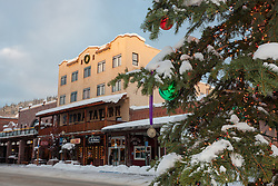"""""""Snowy Christmas Tree in Truckee 6"""" - This snow covered Christmas tree was photographed in Downtown Truckee, California with the Sierra Tavern in the background."""