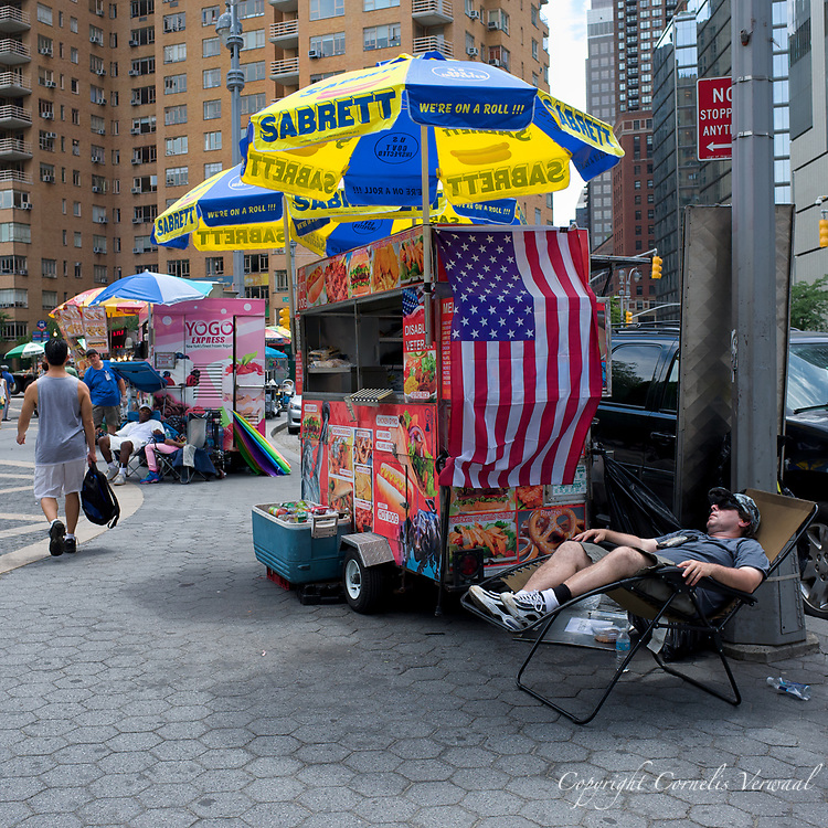This vendor has a relaxed attitude towards his buiseness on Columbus Circle, New York City