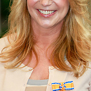 NLD/Huizen/20110429 - Lintjesregen 2011, Linda de Mol
