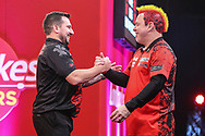 Jonny Clayton beats Peter Wright in the semi final and celebrates during the PDC Ladbrokes Masters 2021 at Marshall Arena, Milton Keynes, United Kingdom on 31 January 2021.