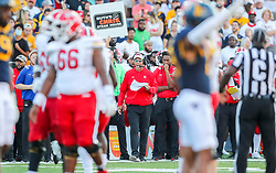 Sep 4, 2021; College Park, Maryland, USA; Maryland Terrapins offensive coordinator Dan Enos calls in a play along the sidelines during the fourth quarter against the West Virginia Mountaineers at Capital One Field at Maryland Stadium. Mandatory Credit: Ben Queen-USA TODAY Sports