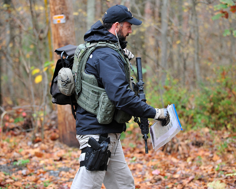 Police and federal agents continue to comb the Pocono Mountains in search of alleged cop killer Eric Matthew Frein Oct. 22, 2014, near Henryville, Pa. (Chris Post   lehighvalleylive.com)