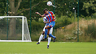 Rochelle Shakes winning the header during the Pre-Season Friendly match between Crystal Palace LFC and Queens Park Rangers Ladies at the The Stadium, Bromley, United Kingdom on 19 July 2015. Photo by Michael Hulf.