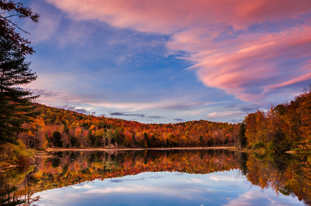Dick Brown Pond & reflections of fall colors, pink dusk colors in sky, Bridgewater, NH