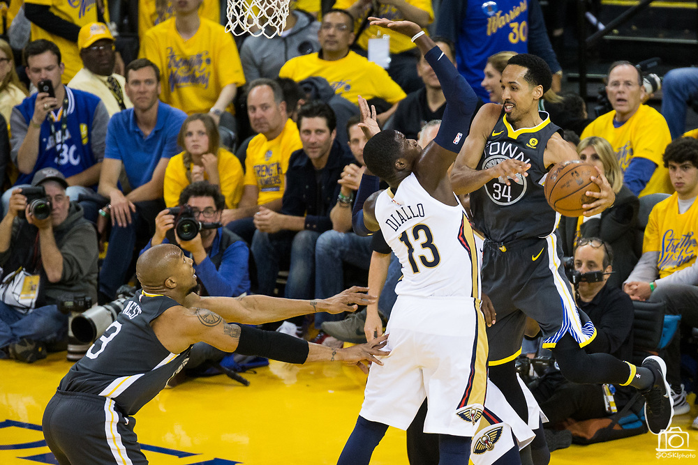 Golden State Warriors guard Shaun Livingston (34) passes to Golden State Warriors forward David West (3) around New Orleans Pelicans forward Cheick Diallo (13) at Oracle Arena during Game 2 of the Western Semifinals in Oakland, California, on May 1, 2018. (Stan Olszewski/Special to S.F. Examiner)