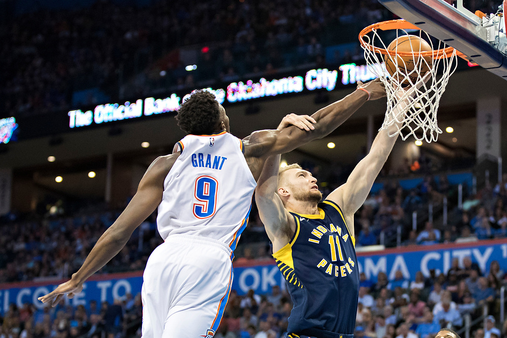 OKLAHOMA CITY, OK - OCTOBER 25:  Jerami Grant #9 of the Oklahoma City Thunder playing defense against Domantas Sabonis #11 of the Indiana Pacers at the Chesapeake Energy Arena on October 25, 2017 in Oklahoma City, Oklahoma.  NOTE TO USER: User expressly acknowledges and agrees that, by downloading and or using this photograph, User is consenting to the terms and conditions of the Getty Images License Agreement.  The Thunder defeated the Pacers 114-96.  (Photo by Wesley Hitt/Getty Images) *** Local Caption *** Jerami Grant; Domantas Sabonis