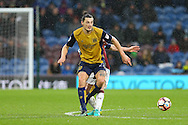 Milan Djuric of Bristol City releases the ball while under pressure from Ben Mee of Burnley. The Emirates FA cup 4th round match, Burnley v Bristol City at Turf Moor in Burnley, Lancs on Saturday 28th January 2017.<br /> pic by Chris Stading, Andrew Orchard Sports Photography.