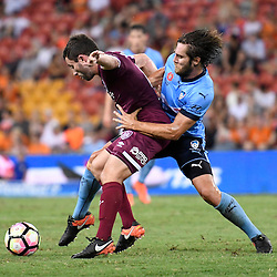 BRISBANE, AUSTRALIA - FEBRUARY 3: Tommy Oar of the Roar controls the ball under pressure from Joshua Brillante of Sydney during the round 18 Hyundai A-League match between the Brisbane Roar and Sydney FC at Suncorp Stadium on February 3, 2017 in Brisbane, Australia. (Photo by Patrick Kearney/Brisbane Roar)