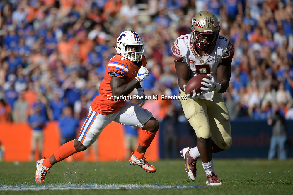 Florida defensive back Duke Dawson (7) defends as Florida State running back Jacques Patrick (9) catches a pass during the second half of an NCAA college football game Saturday, Nov. 25, 2017, in Gainesville, Fla. FSU won 38-22. (Photo by Phelan M. Ebenhack)