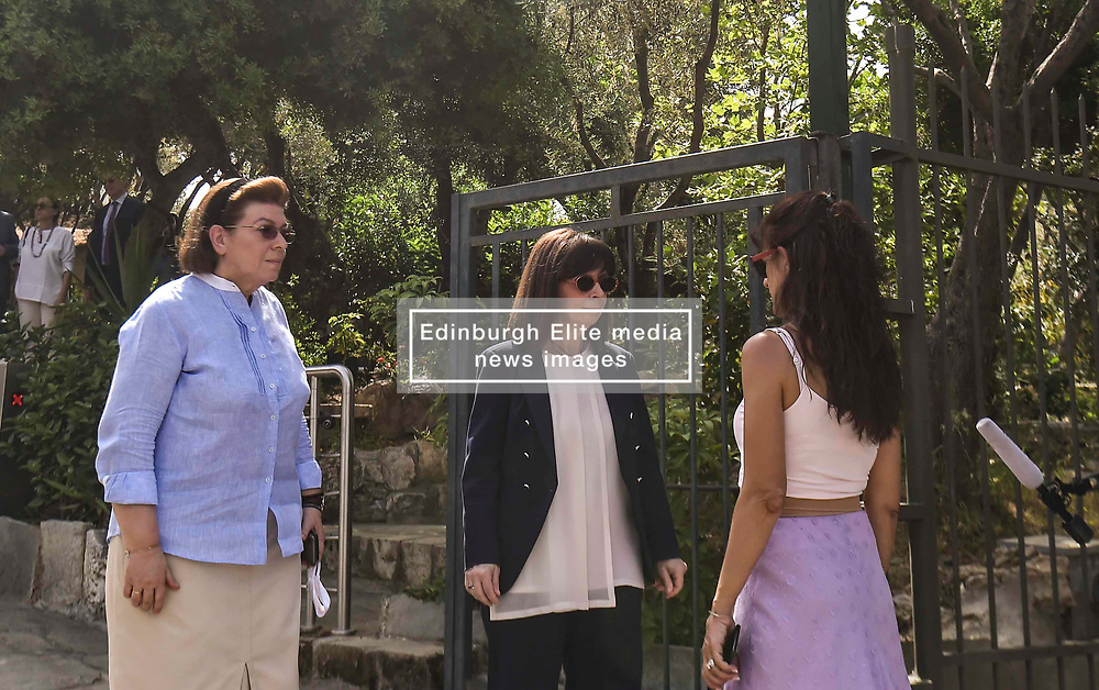 Pictured: president Sakelaropoulou Aikarerini (centre) is interviewed by the press as she visits the Acropolis<br /> The ancient Acropolis in Athens has reopened to the public today.  The vast site has restricted visitor numbers to 2,000 to enable appropriate social distancing to be in operation<br /> <br /> Dimitris Lampropoulos    EEm 18 May 2020