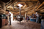 """Che, Kat and Kathleen...Meeting with Kat, a Navajo Indian shepherd living in a traditional Hogan (the primary traditional home of the Navajo people, similar in appearance to a Yurt) in the Black Mesa. Black Mesa is an upland area in Navajo County, Arizona, it derives its dark appearance from the numerous seams of coal which run through it. .Kat resisted the relocation imposed by US law that  intended to encourage Native Americans to leave Indian reservations and assimilate into the general population - in order to better exploit natural ressources available on the reservations. The relocations played a decisive role in increasing the population of urban Indians...A 4-weeks road trip across the USA, from New York to San Francisco, on the steps of Jack Kerouac's famous book """"On the Road"""".  Focusing on nomadic America: people that live on the move across the US, out of ideology or for work reasons."""