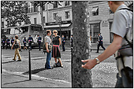 DAY TRIPPER - PARIS PARADE - people street photo art by Paul Williams taken on 15th July 2007 of day trippers watching the annual Bastille parade in Paris