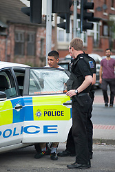 South Yorkshire Police NE Sheffield Safer Neighburhoods Team working in the Page Hall area of Sheffield<br /> <br /> 15 August 2013<br /> Image © Paul David Drabble<br /> www.pauldaviddrabble.co.uk