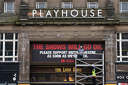 Edinburgh, Scotland, UK. 28 October 2020.  Workers at the Edinburgh Playhouse theatre have removed billboards for The Lion King production that was cancelled and replaced it with sign stating that The Shows Will Go On. The British theatre industry is suffering severe difficulties due to Covid-19 pandemic. Iain Masterton/Alamy Live News