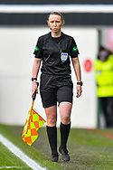 Assistant referee, Kylie McMullan on the touchline during the SPFL Premiership match between Hibernian FC and Motherwell FC at Easter Road, Edinburgh, Scotland on 27 February 2021.