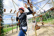 """Amber Schroeder makes it across a challenging rope bridge at the Jackson Hole Mountain Resort ropes course on Thursday morning. """"It wasn't so bad,"""" said Schroeder who made several laps around the new attraction with her son. Various elements included in the course offer participants a wide range of difficulty."""