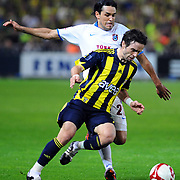 Fenerbahce's Gokhan GONUL (F) and Trabzonspor's Gustavo COLMAN (B) during their Turkish superleague soccer derby match Fenerbahce between Trabzonspor at the Sukru Saracaoglu stadium in Istanbul Turkey on Sunday 16 May 2010. Photo by TURKPIX