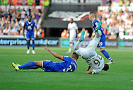 Kyle Naughton is tackled by Everton's Brendan Galloway in the second half.<br /> Barclays Premier League match, Swansea city v Everton at the Liberty Stadium in Swansea, South Wales on Saturday 19th September 2015.<br /> pic by Phil Rees, Andrew Orchard sports photography.