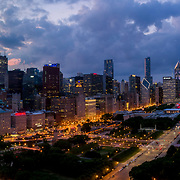 Chicago Loop aerial views at dusk in 2019. Buckingham Fountain and Grant Park in foreground.