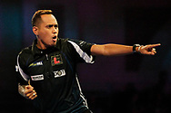Lourence Ilagan hits a double to win the leg during the World Championship Darts 2018 at Alexandra Palace, London, United Kingdom on 17 December 2018.