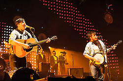 "© Licensed to London News Pictures. 11/12/2012. London, UK.   Marcus Mumford (left) and Ted Dwane (right) of Mumford & Sons performing live at The O2 Arena. Mumford & Sons are an English folk rock band. The band consists of Marcus Mumford (vocals, guitar, drums, mandolin), Ben Lovett (vocals, keyboards, accordion, drums), ""Country"" Winston Marshall (vocals, banjo, dobro, guitar), and Ted Dwane (vocals, string bass, drums, guitar).  Photo credit : Richard Isaac/LNP"