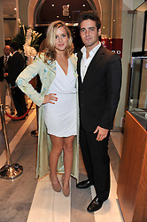 CAGGIE DUNLOP and SPENCER MATTHEWS at a reception to unveil the ISAF World Match Racing Tour Championship Trophy at Garrard, 24 Albemarle Street, London W1 on 7th November 2011.