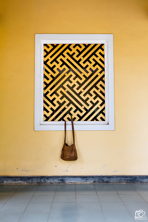 A satchel hangs from the window of the Chua Dieu Vien Pagoda in Hue, Vietnam.  Photo by Stan Olszewski/SOSKIphoto