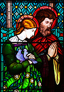 Stained glass window by Henry Holiday 1863 Shimpling church, Suffolk, England, UK Pre-Raphaelite artist - Mary and Joseph