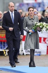 The Duke and Duchess of Cambridge lay flowers at the tribute site near to Leicester City Football ClubÕs King Power Stadium, during a visit to Leicester to pay tribute to those who were killed in the helicopter crash last month.