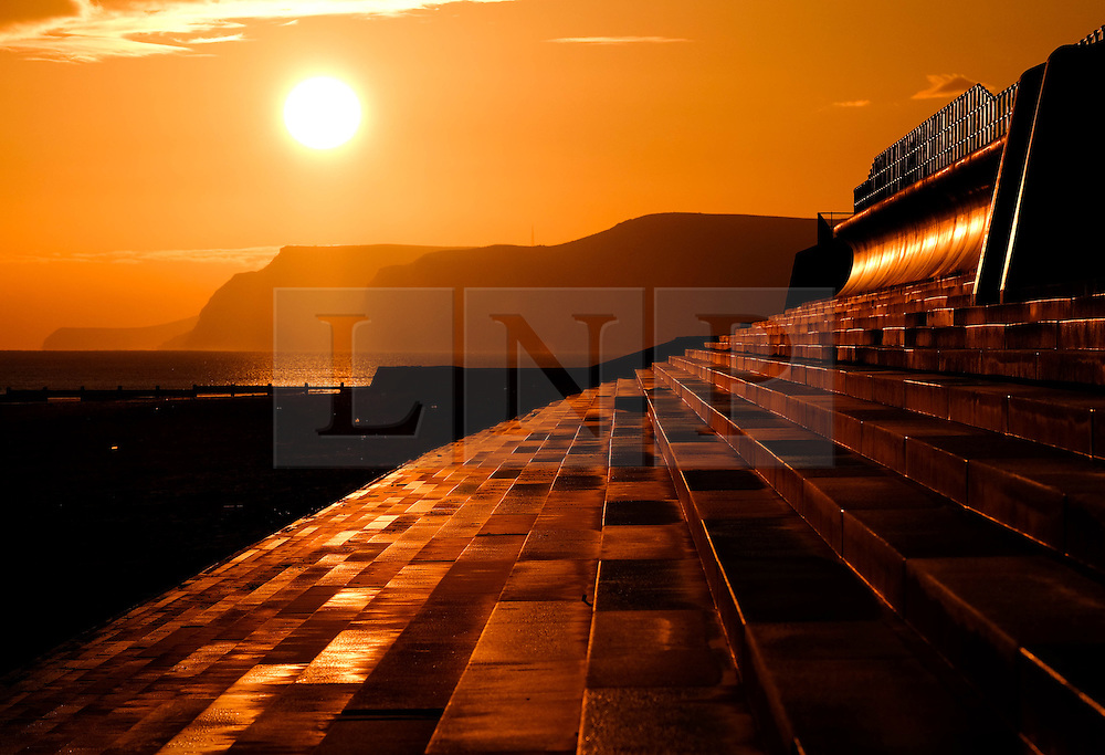 © Licensed to London News Pictures. 19/02/16<br /> Redcar, UK. <br /> <br /> The rising sun is reflected on the concrete steps leading up to the sea wall at Redcar beach in Cleveland. <br /> <br /> Photo credit : Ian Forsyth/LNP