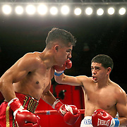 Olympian Antonio Vargas (R) fights against Luis Fernando Saavedra during a Telemundo boxing match between at Osceola Heritage Park on Friday, February 23, 2018 in Kissimmee, Florida.  (Alex Menendez via AP)