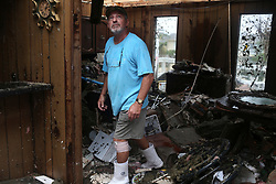 August 28, 2017 - Rockport, Texas, U.S.- Homebuilder ROBERT JACKSON, 59, checks out the damage to a house he was renovating in the affluent Key Allegro neighborhood between Fulton and Rockport. The eye of Hurricane Harvey made landfall in the area Friday night. (Credit Image: © Jerry Lara/San Antonio Express-News via ZUMA Wire)